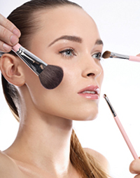 Model with makeup brushes